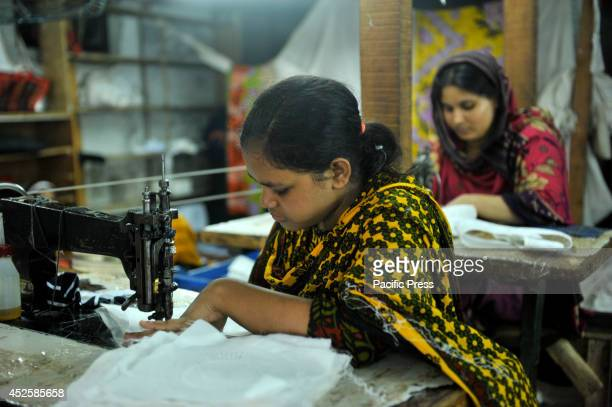 A woman sews an Islamic cap in the Alif Cap Garments at Dhaka The Islamic cap is one of the most important things for all Muslims when Ramadan comes...