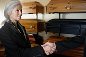 Woman Shaking Hands in Funeral Parlor