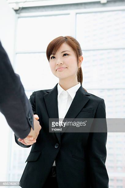 Woman shaking hands in suit