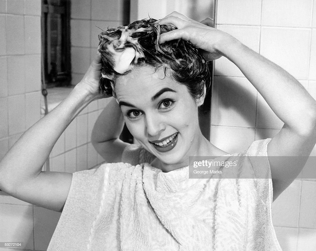 Woman shampooing her hair : Stock Photo