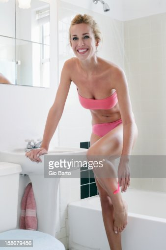woman shaving in bathroom   Stock Photo. Woman Shaving In Bathroom Stock Photo   Getty Images