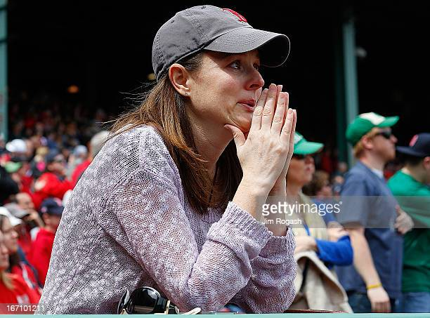A woman sheds a tear during pregame ceremonies in honor of the Marathon bombing victims before a game between the Boston Red Sox and the Kansas City...