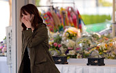 A woman sheds tear after offering a flower at an altar at the accident site of the JR Takarazuka Line on the 10th anniversary of the train derailment...