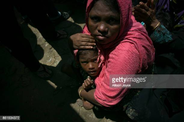 COX'S BAZAR BANGLADESH SEPTEMBER 22 A woman shields her baby from a crowd during an aid distribution on September 22 2017 in Cox's Bazar Bangladesh...
