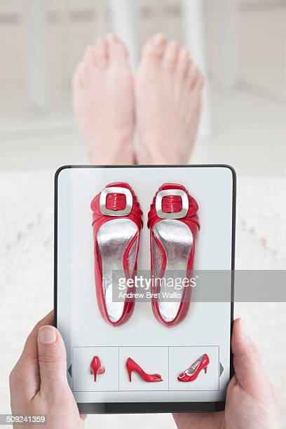 Woman shoe shopping on-line with computer tablet