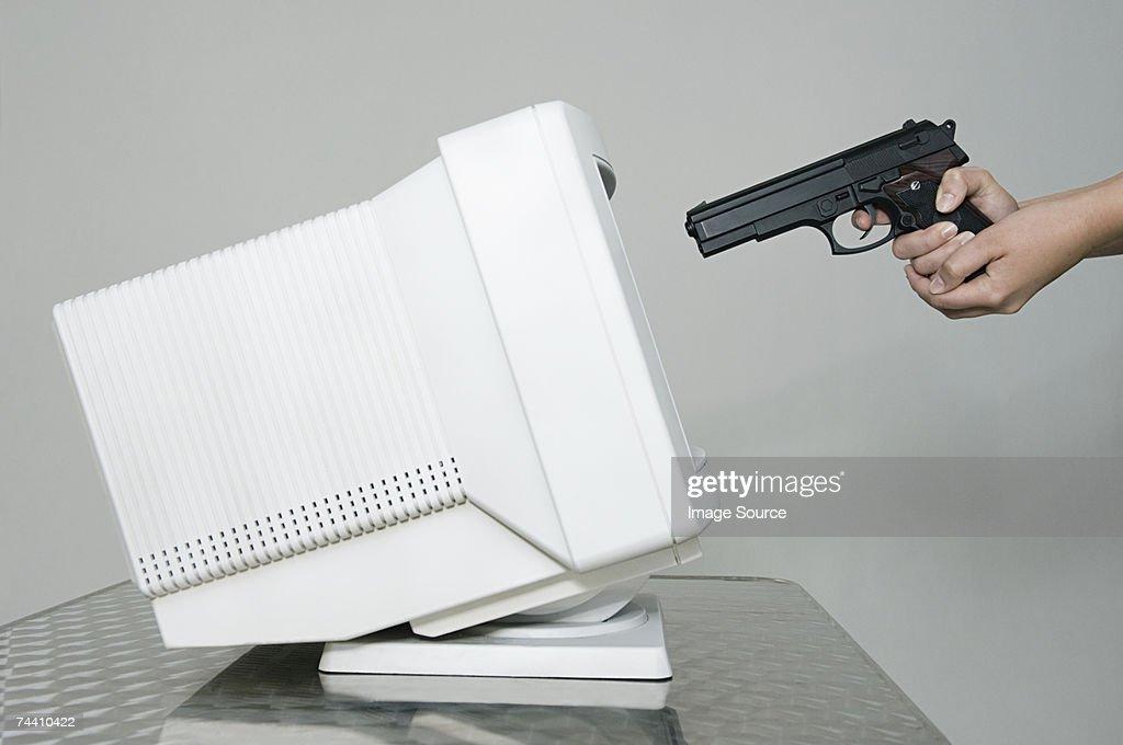 Woman shooting computer monitor