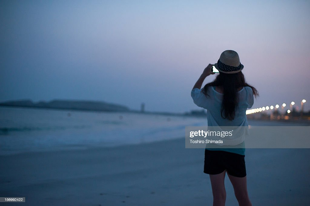 A woman shooting in the dawn : Stock Photo
