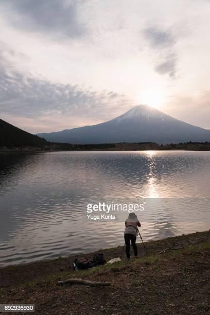 Woman Shooting Mt. Fuji at Lake Tanuki at Sunrise