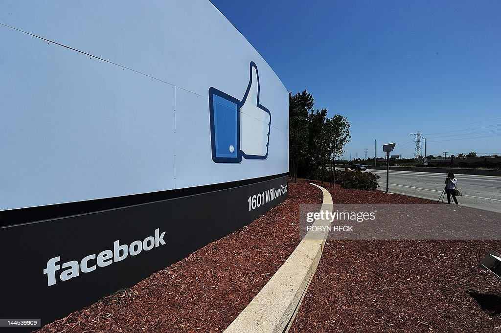 A woman shoots video of the sign at the entrance to the Facebook main campus in Menlo Park, California, May 15, 2012. Facebook, the world's most popular internet social network, expects to raise USD $12.1 billion in what will be Silicon Valley's largest-ever initial public offering (IPO) later this week.