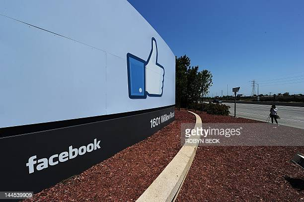A woman shoots video of the sign at the entrance to the Facebook main campus in Menlo Park California May 15 2012 Facebook the world's most popular...