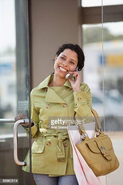 Woman shopper using mobile phone