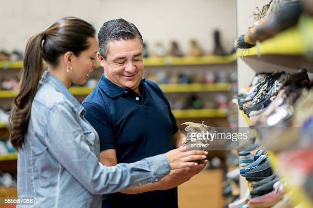 Woman shopping and  talking to sales manager