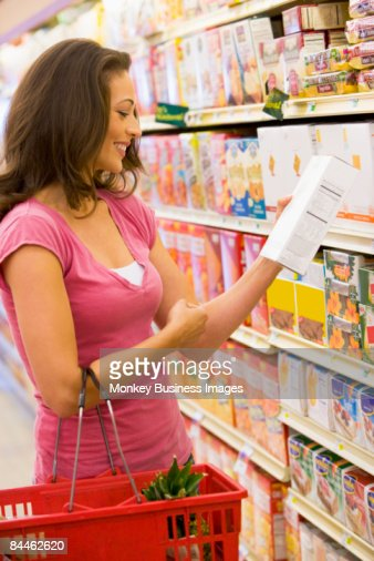 Woman shopping at a grocery store : Stock Photo