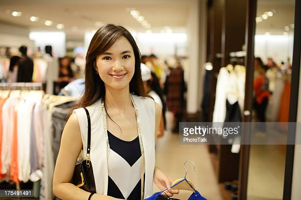 Woman Shopping At Clothing Store - XXXXXLarge