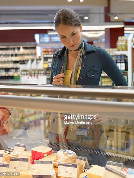Woman Shopping at Dairy Counter
