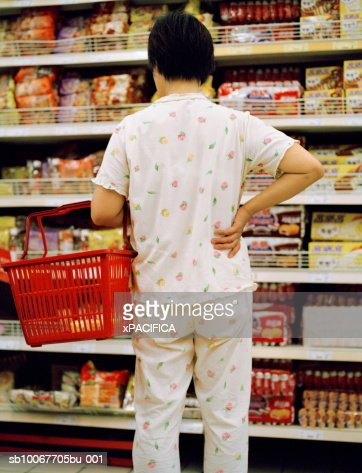 Woman shopping at grocery store, rear view : Stock Photo