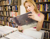 Woman shopping for albums in record store