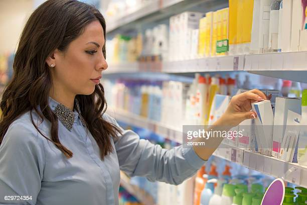 Woman shopping for beauty product