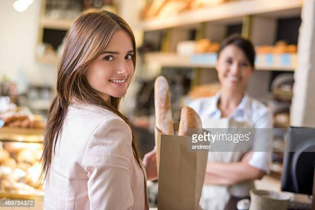 Woman shopping for bread at a bakery