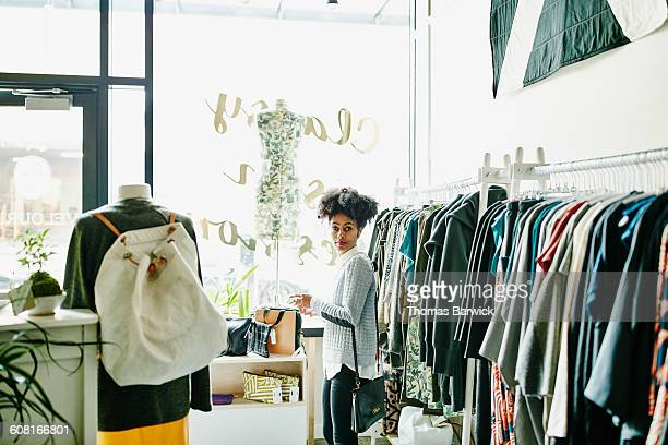 Woman shopping for clothing in boutique shop