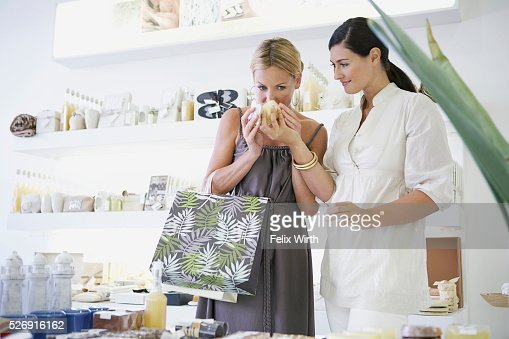 Woman shopping for cosmetics : Stock Photo