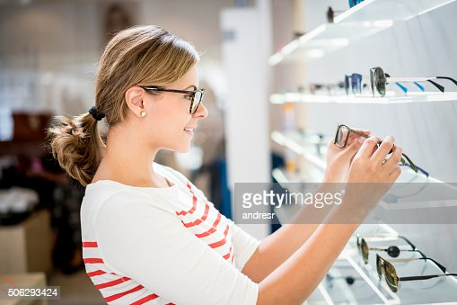 Woman shopping for glasses at the optics
