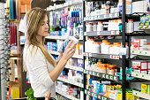 Woman shopping in store buying health and beauty supplies