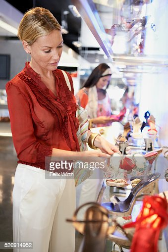 Woman shopping for high heels : Stock Photo
