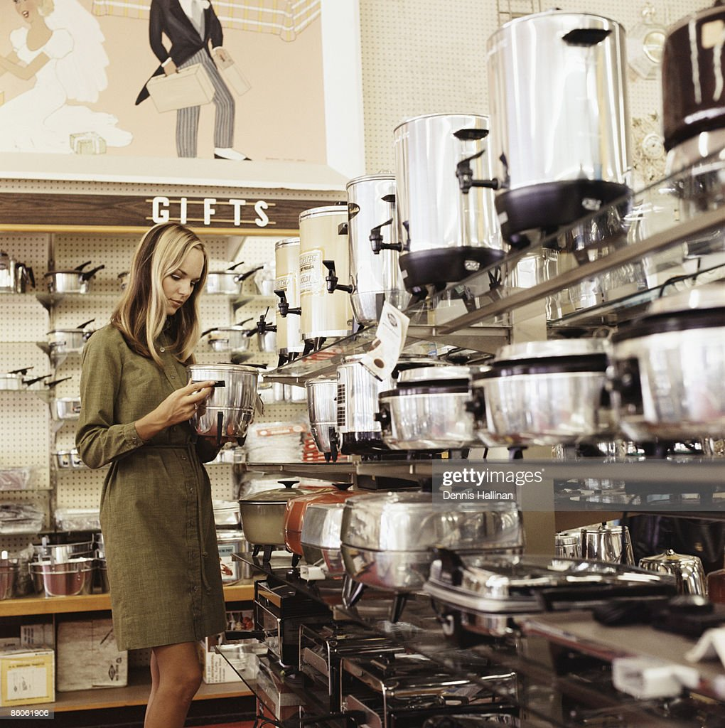 Woman shopping for kitchen appliances : Stock Photo