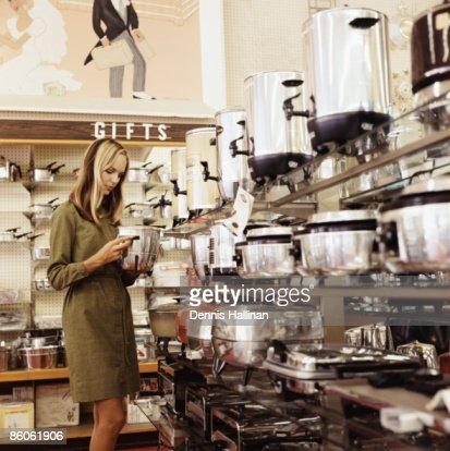 Woman shopping for kitchen appliances : Stock Photo