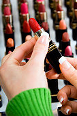 Woman shopping for lipstick