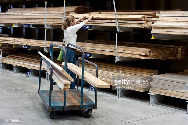 Woman shopping for lumber