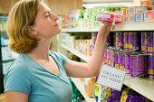 Woman shopping for organic pet food