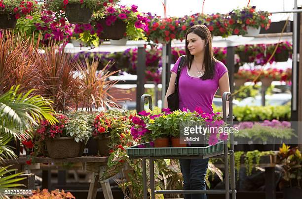 Woman Shopping for Plants at a Outdoor Garden Center.
