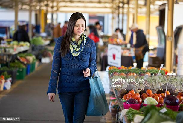 Woman Shopping for Produce at a Farmers Market.