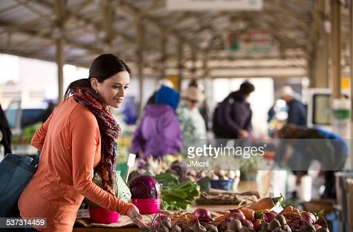 Woman Shopping for Produce at a Midwest Farmers Market.