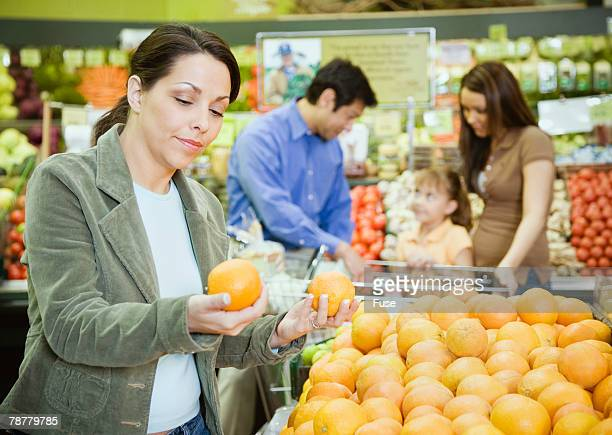 Woman Shopping for Produce at Health Food Store