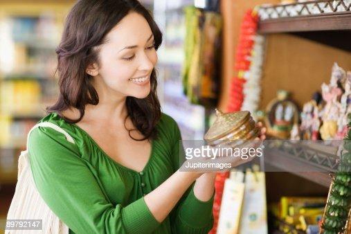 Woman shopping for souvenir : Stock Photo