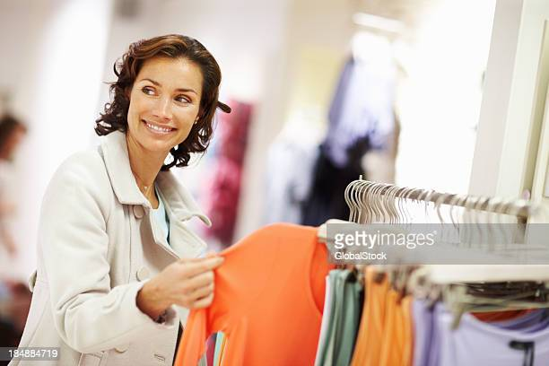 Woman shopping for top