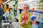 Woman Shopping for Yogurt in Supermarket