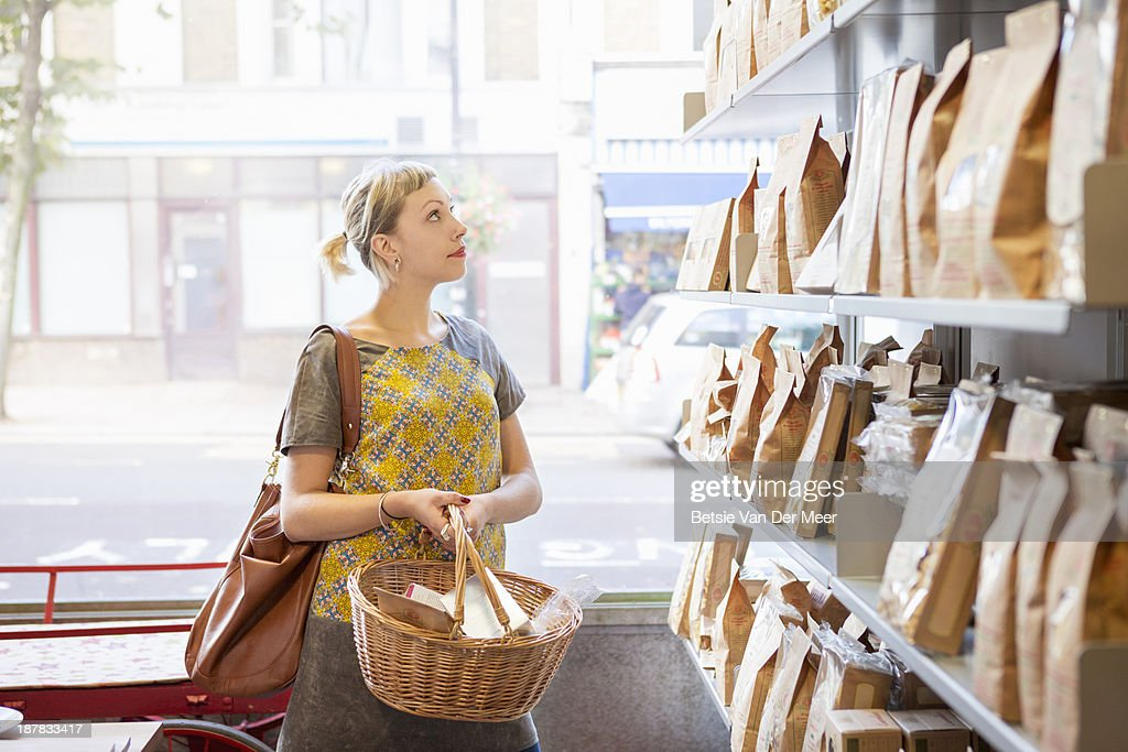Woman shopping in delicatessen shop. : Stock Photo
