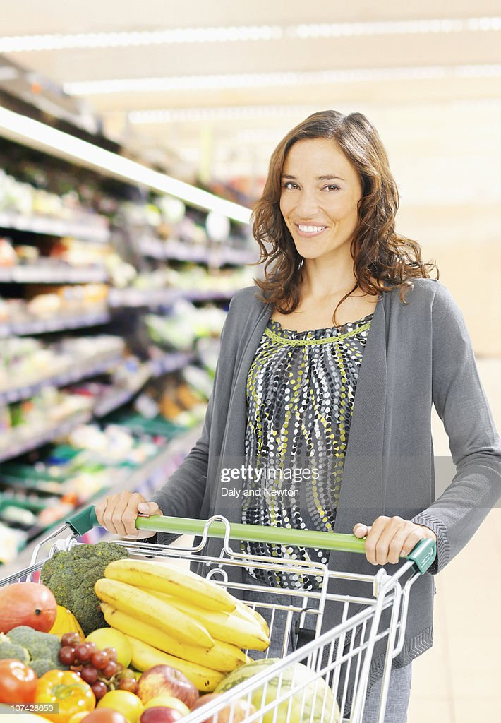 Woman shopping in grocery store : Stock Photo