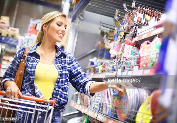 Woman shopping in local supermarket.