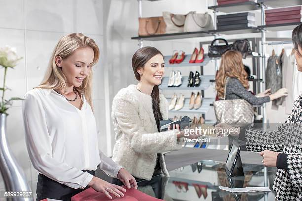 Woman shopping in luxury boutique