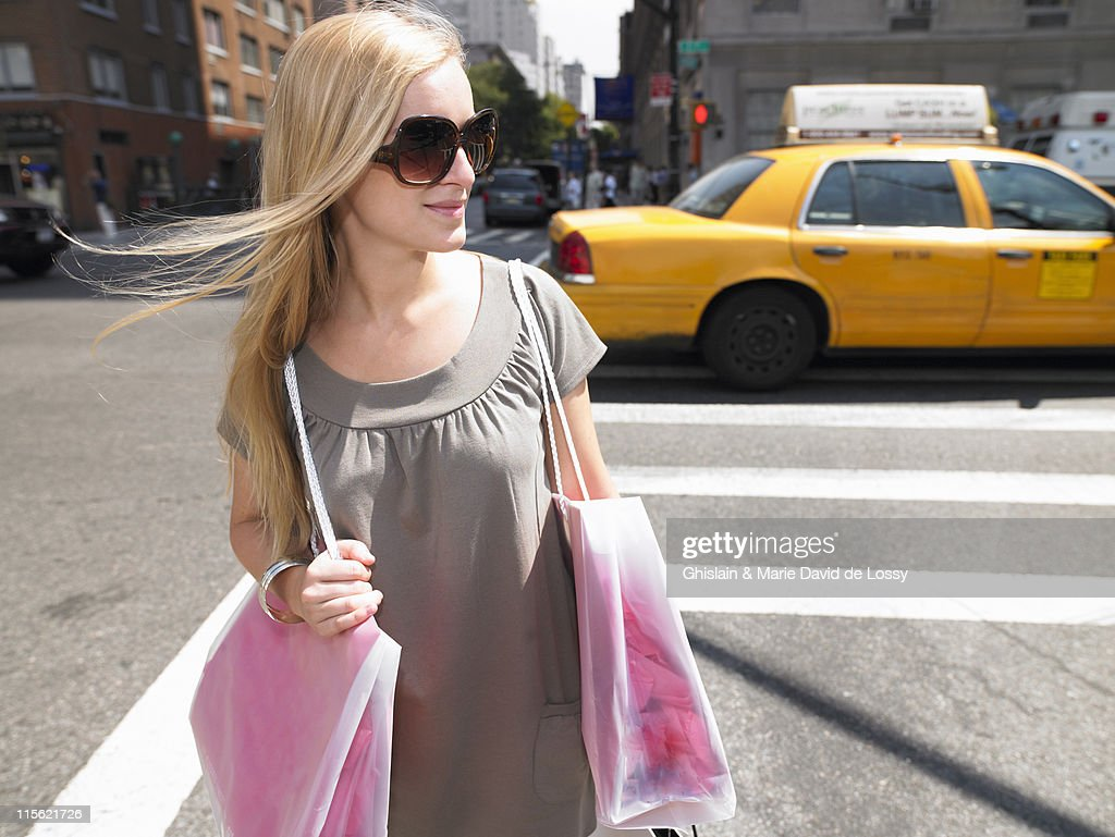 Woman shopping in New-York City : Stock Photo