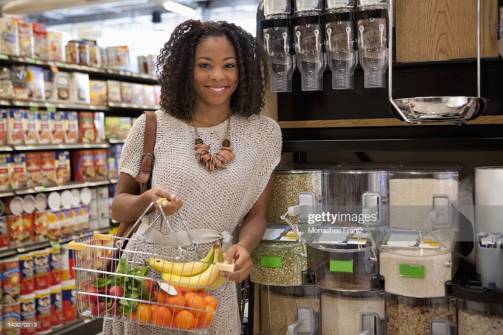 Woman shopping in supermarket : Stock Photo