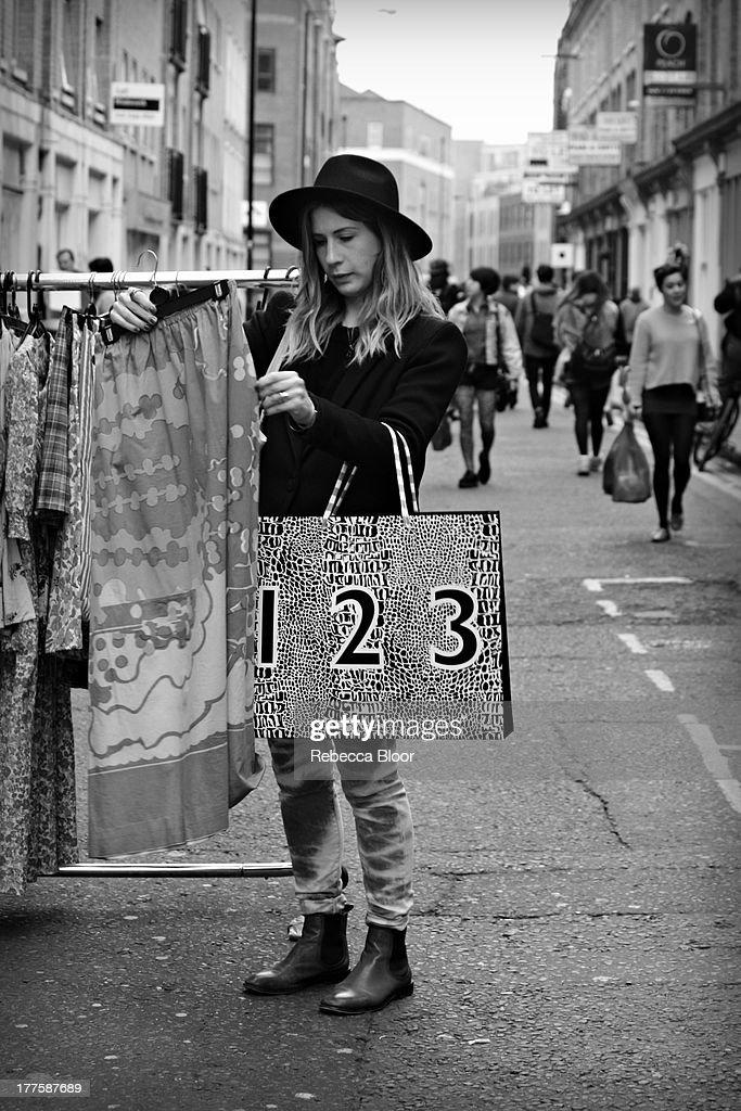 CONTENT] Woman shopping in vintage market. Brick Lane, London, 2012
