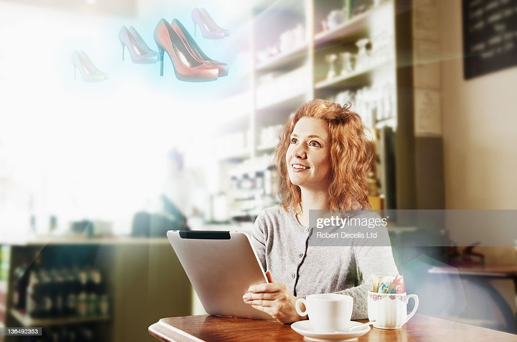 Woman shopping on internet in cafe : Stock Photo