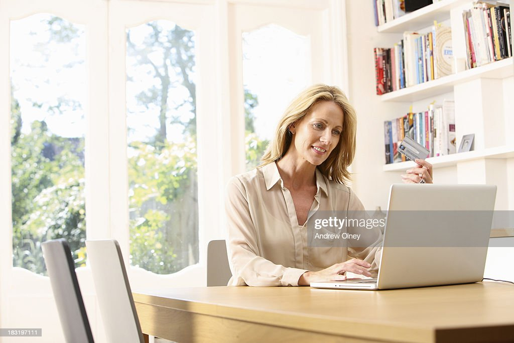 Woman shopping online at home : Stock Photo