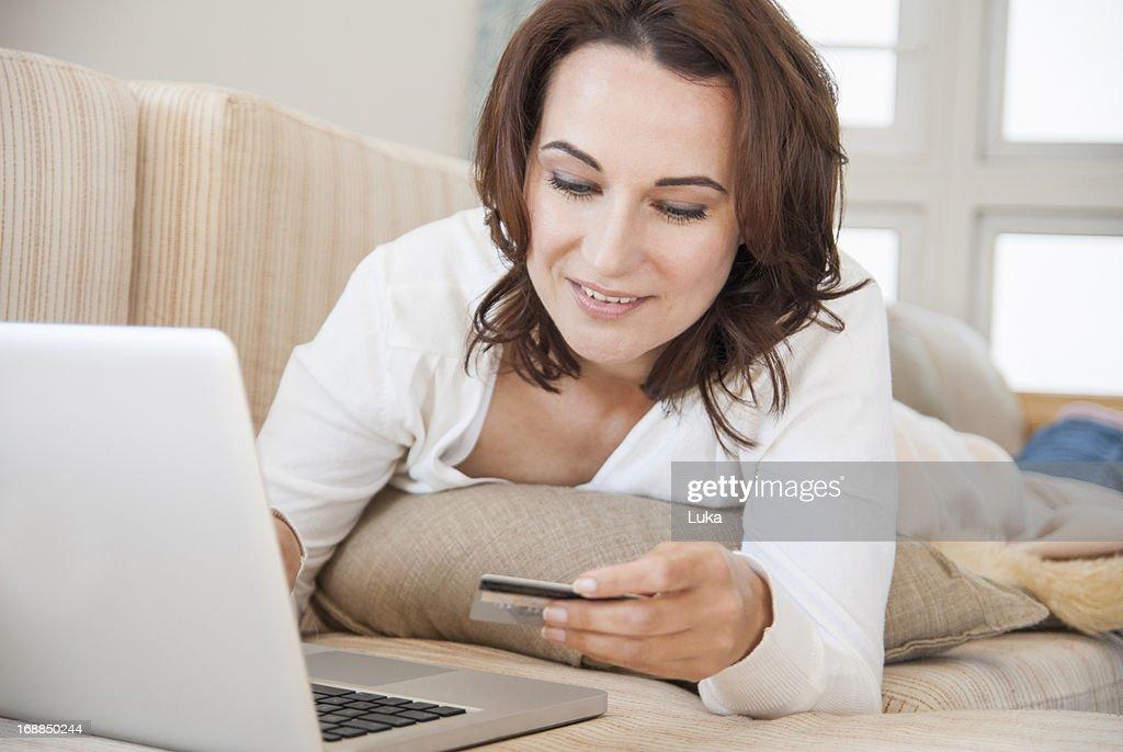 Woman shopping online on sofa : Stock Photo